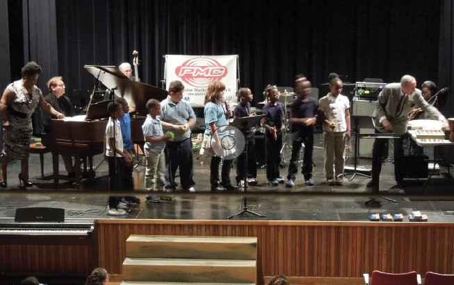Local 4 (Cleveland, OH) members Pat Harris, pianist Dan Maier, bassist Tim Powell, and percussionist Karl Dustman perform with students from Case Elementary School at the Rainey Institute.