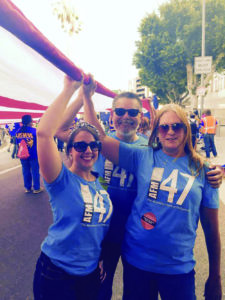 Local 47 (Los Angeles, CA) Communications Director Linda Rapka, along with members Michael Ankney and Diane Lauerman, carried Old Glory from Chinatown to City Hall as part of a May Day march and celebration in Chinatown.