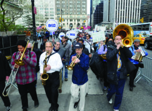 Local 802 (New York City) musicians led a May Day march at a rally to end income inequality. In the front row (L to R) are: Chris Bates (trombone), Jay Branford (saxophone), Kevin Blanq (leader, trumpet), Rick Faulkner (trombone). Behind them are Dale Turk (trombone), Stephen Schatz (drum), Brevan Hampden (drum), Kenny Bentley (sousaphone), and Paul Stein (melodica). Justice for Jazz Artists used the day to call attention to their cause: for the owners of the jazz clubs where musicians perform to contribute to a pension for the musicians.