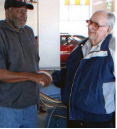 """Local 362-691 Board Member Leonard """"Pappy"""" Battise (left) congratulates Secretary Bill Spurlock for his many years of dedicated service to the local."""