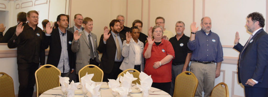 Above, AFM President Hair swears in 2015–2016 TMA Executive Board members present. Elected were: President Tom Mendel of Local 10-208 (Chicago, IL), Vice President Walter Usiatynski of Local 802 (New York City), Secretary-Treasurer Mark Pinto of Local 9-535 (Boston, MA), Director for Broadway Jan Mullen of Local 802, Director for the Membership-at-Large Lovie Smith-Wright of Local 65-699 (Houston, TX), and Director for Travelers Angela Chan of Local 369 (Las Vegas, NV). Locally elected chapter directors include: Tony D'Amico (Boston), Dan Johnson (Chicago), Alan Ayoub (Detroit), David Philippus (Las Vegas), Steve Sanders (Northern California), Jeff Martin (Phoenix), Paul Castillo (Southern California), Vicky Smolik (St. Louis), and Paul Schultz (Washington, DC).