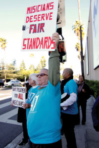 "Members of AFM Local 47 (Los Angeles, CA) and other supporting unions such as UNITE HERE!, demonstrated and leafleted in front of Warner Bros. after discovering evidence of a ""dark""  scoring session."
