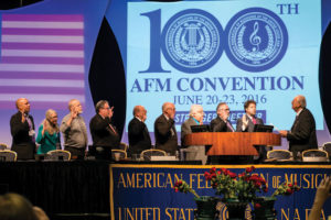 AFM International officers are sworn in by President Emeritus Mark Tully Massagli at the close of the 100th AFM Convention. (L to R): AFM IEB members John Acosta, Tina Morrison, Dave Pomeroy, Tino Gagliardi, and Joe Parente; Secretary-Treasurer Jay Blumenthal; Vice President from Canada Alan Willaert; Vice President Bruce Fife; and President Ray Hair.